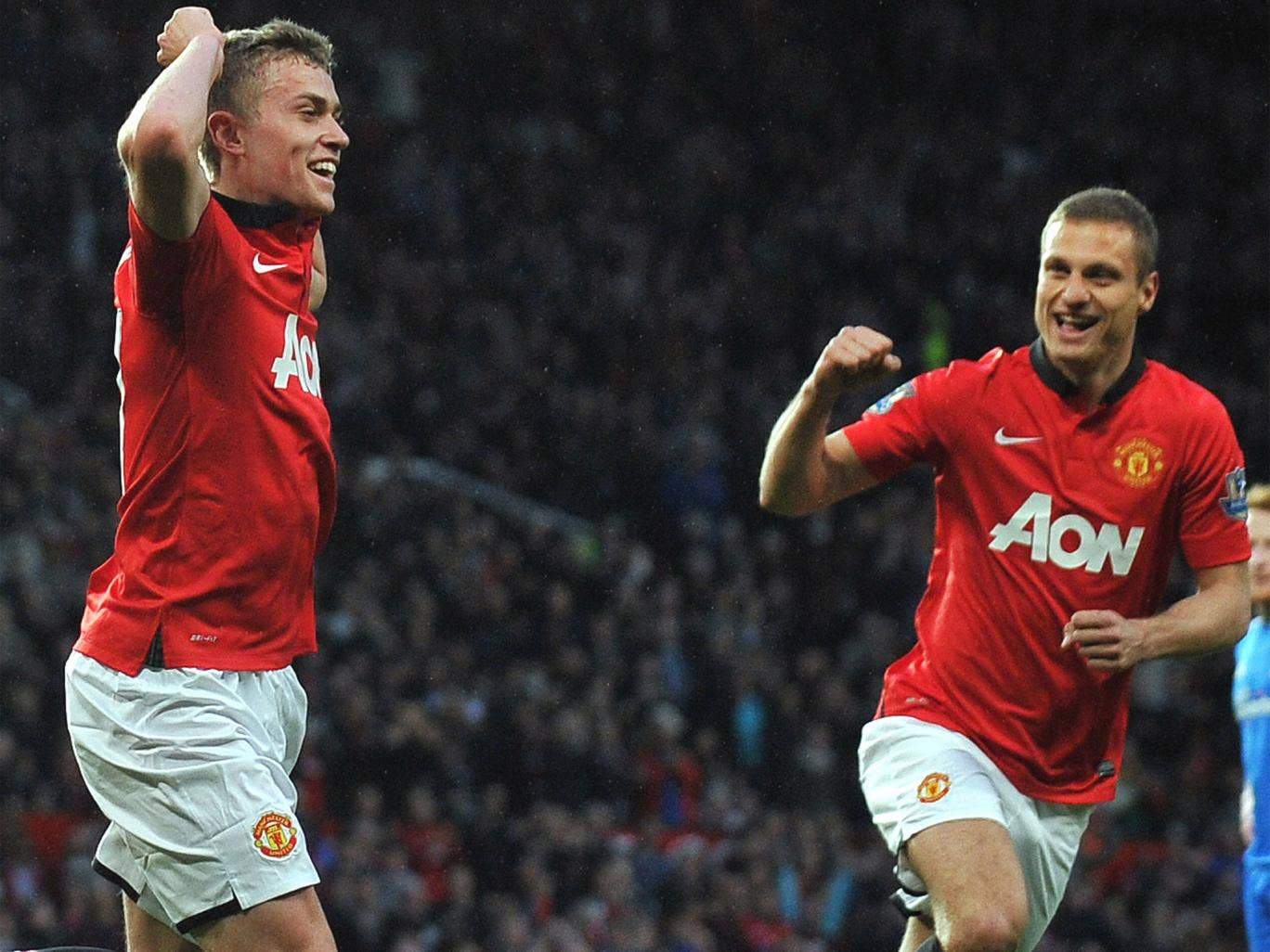 James Wilson celebrates with Nemanja Vidic, who was making his last appearance at Old Trafford for United
