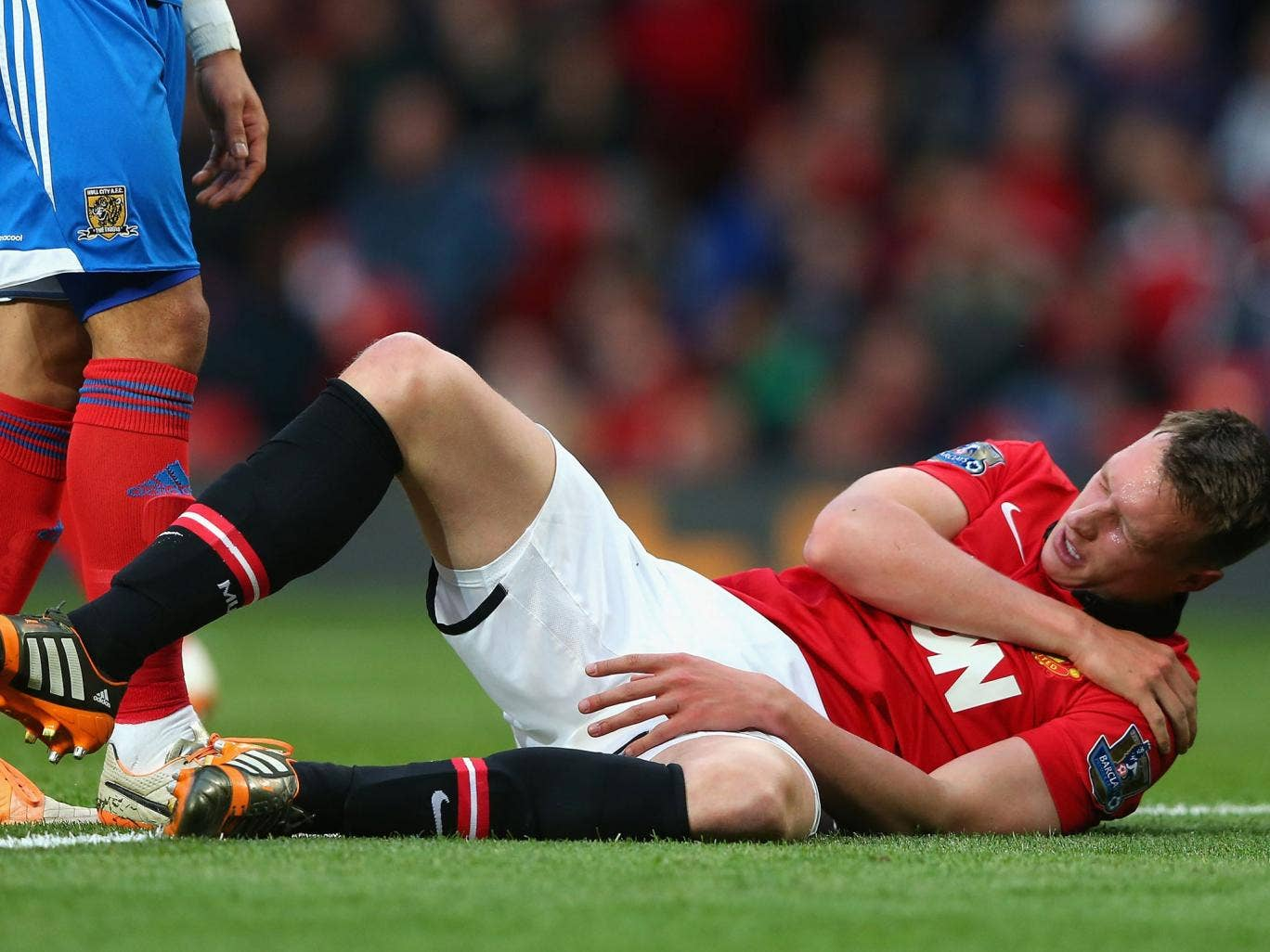 Phil Jones goes down clutching his shoulder in Manchester United's 3-1 win over Hull