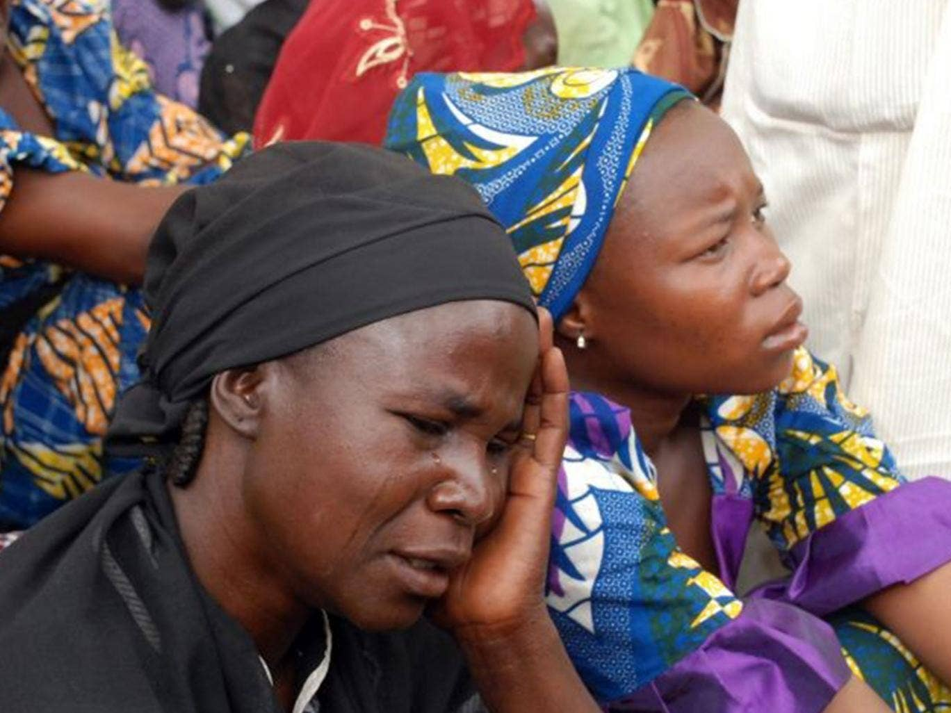 Mothers of the missing Chibok school girls abducted by Boko Haram Islamists gather to receive information from officials