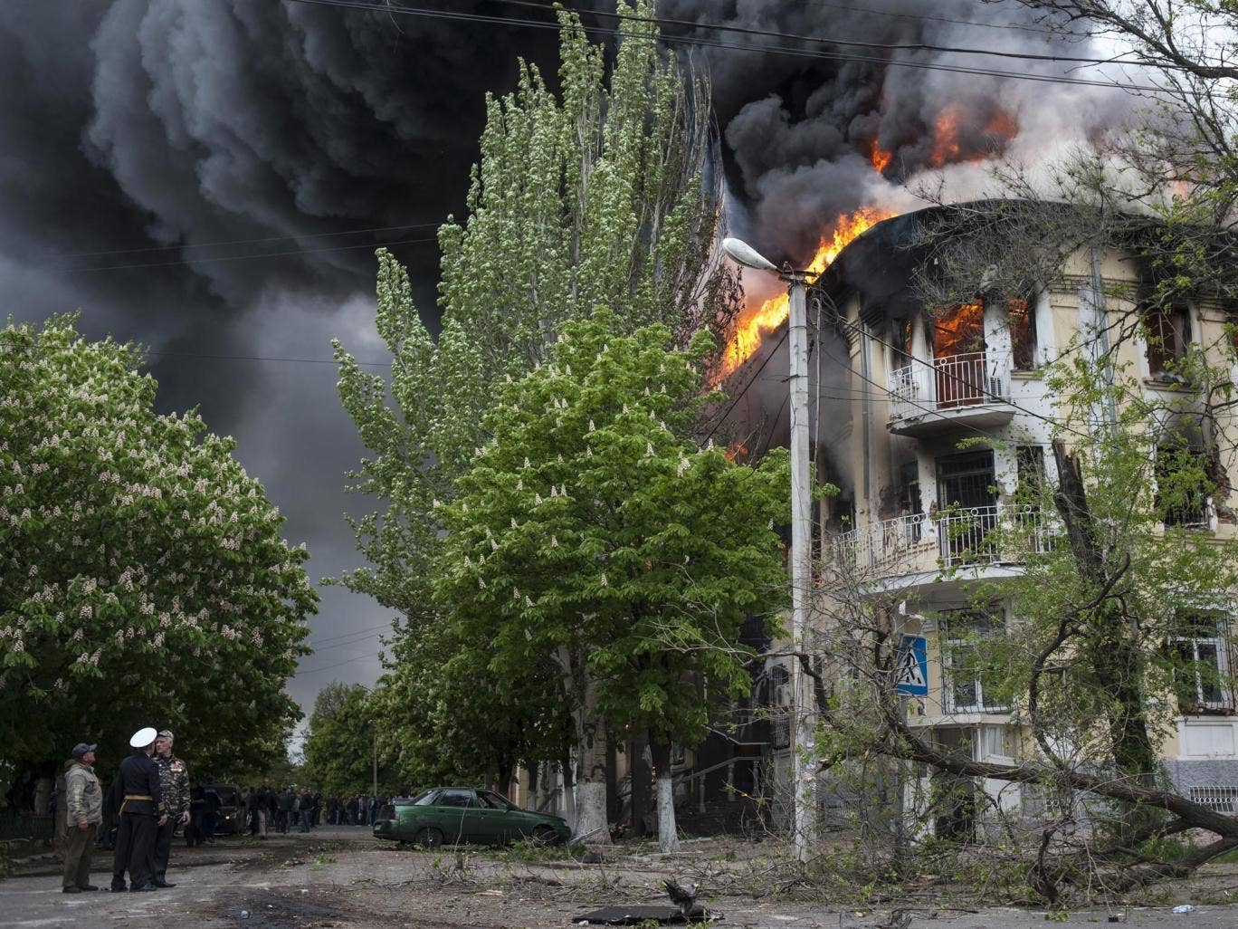 A police station is ablaze in Mariupol, eastern Ukraine