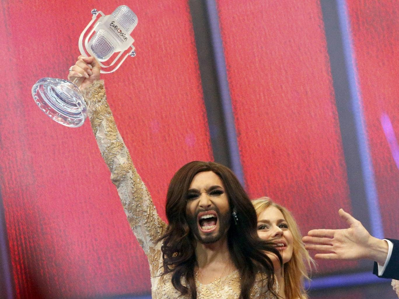 Conchita Wurst representing Austria celebrates after winning the grand final of the 59th Eurovision Song Contest