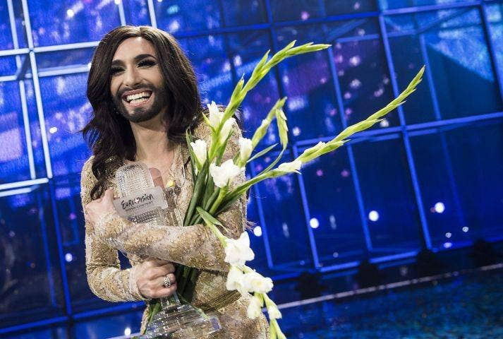 Conchita Wurst poses with the trophy after winning Eurovision