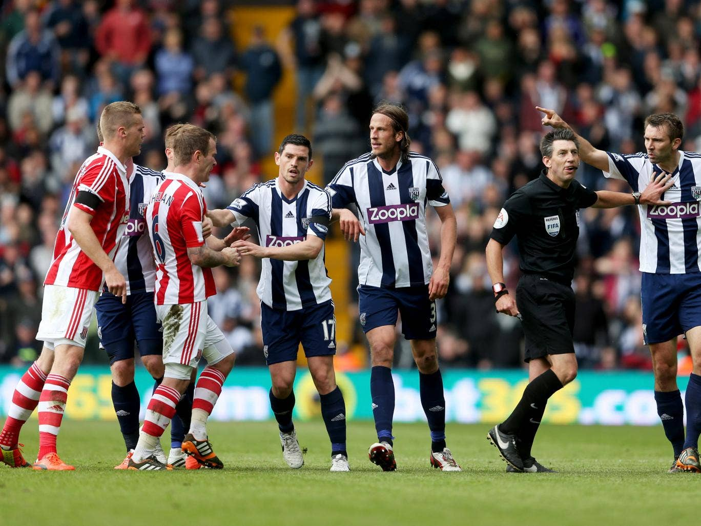 Stoke and West Brom players clash