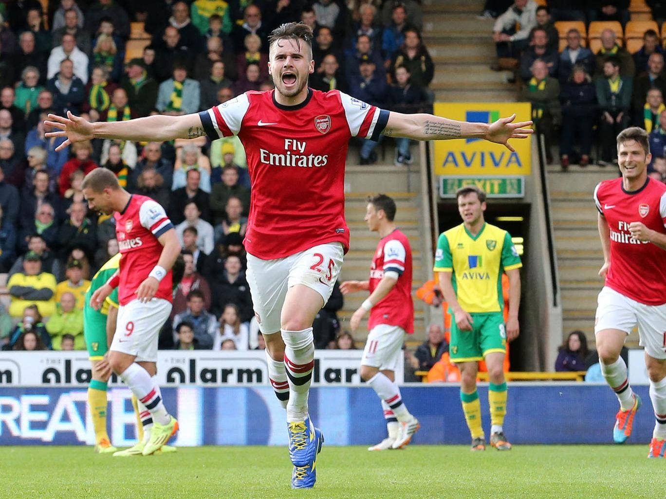 Carl Jenkinson celebrates scoring the away side's second, his first goal for the club
