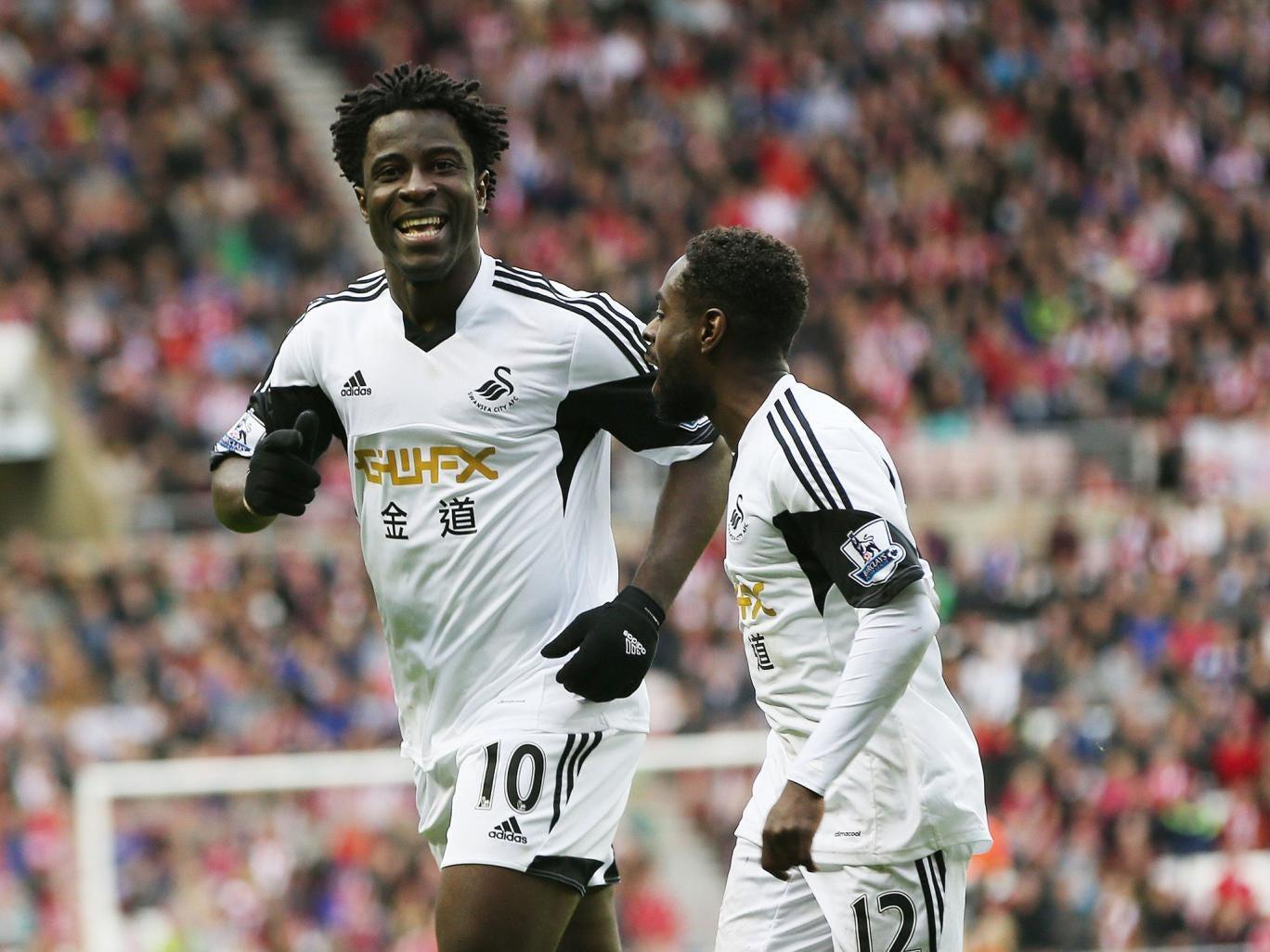 Wilfried Bony celebrates scoring the away side's third