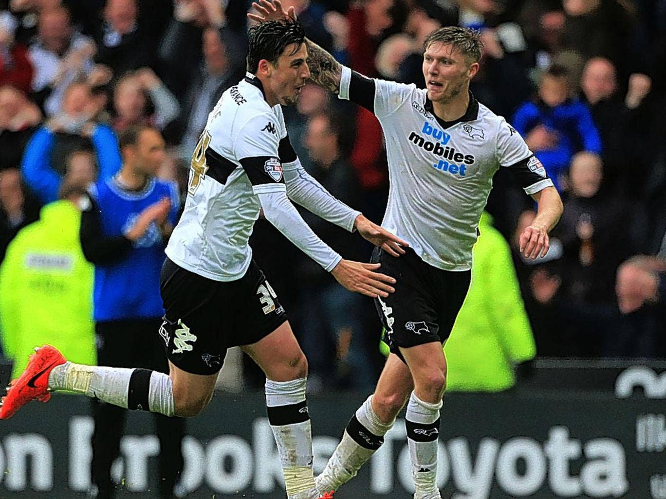 Midfielder George Thorne is congratulated by Jeff Hendrick after scoring Derby County's third goal