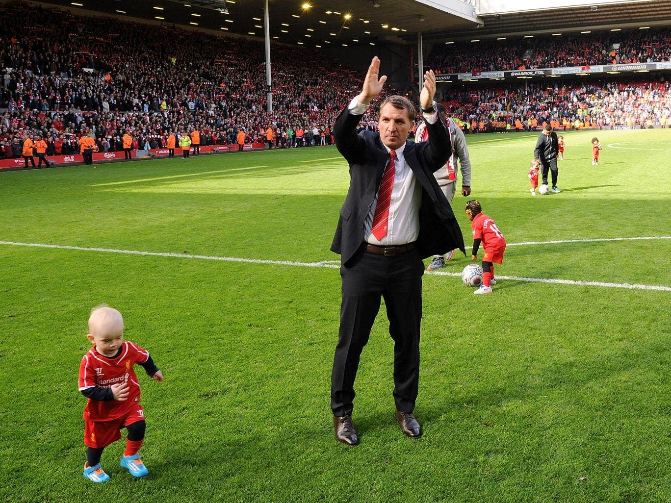 Brendan Rodgers applauds the Liverpool fans for their support this season after the 2-1 win over Newcastle