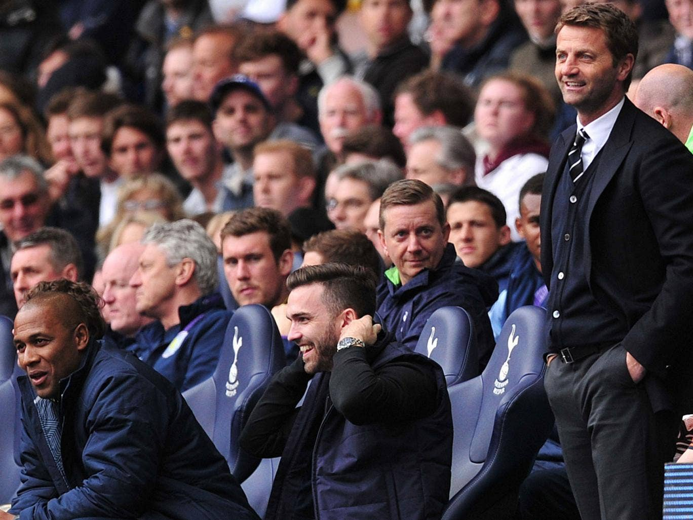 Tim Sherwood (right) with the supporter sitting in the dugout