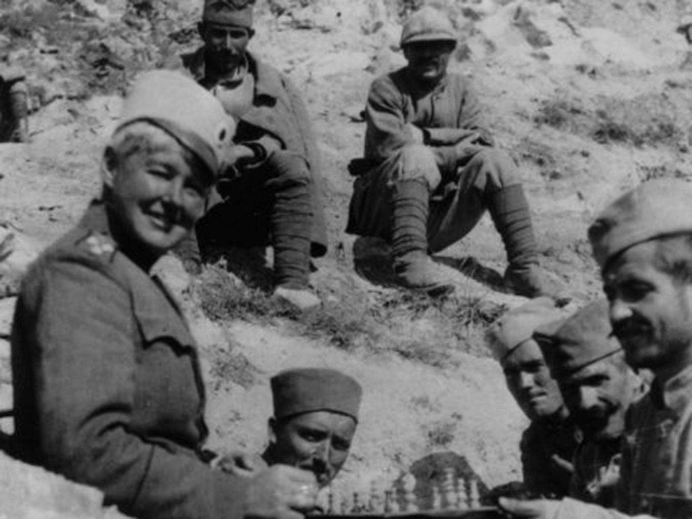 Flora Sandes, who rose from private to sergeant-major in the Serbian army, playing chess with her Serbian comrades. After the war ended, she was promoted to lieutenant