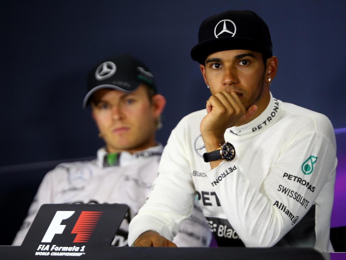 Nico Rosberg looks at Lewis Hamilton following the Spanish Grand Prix