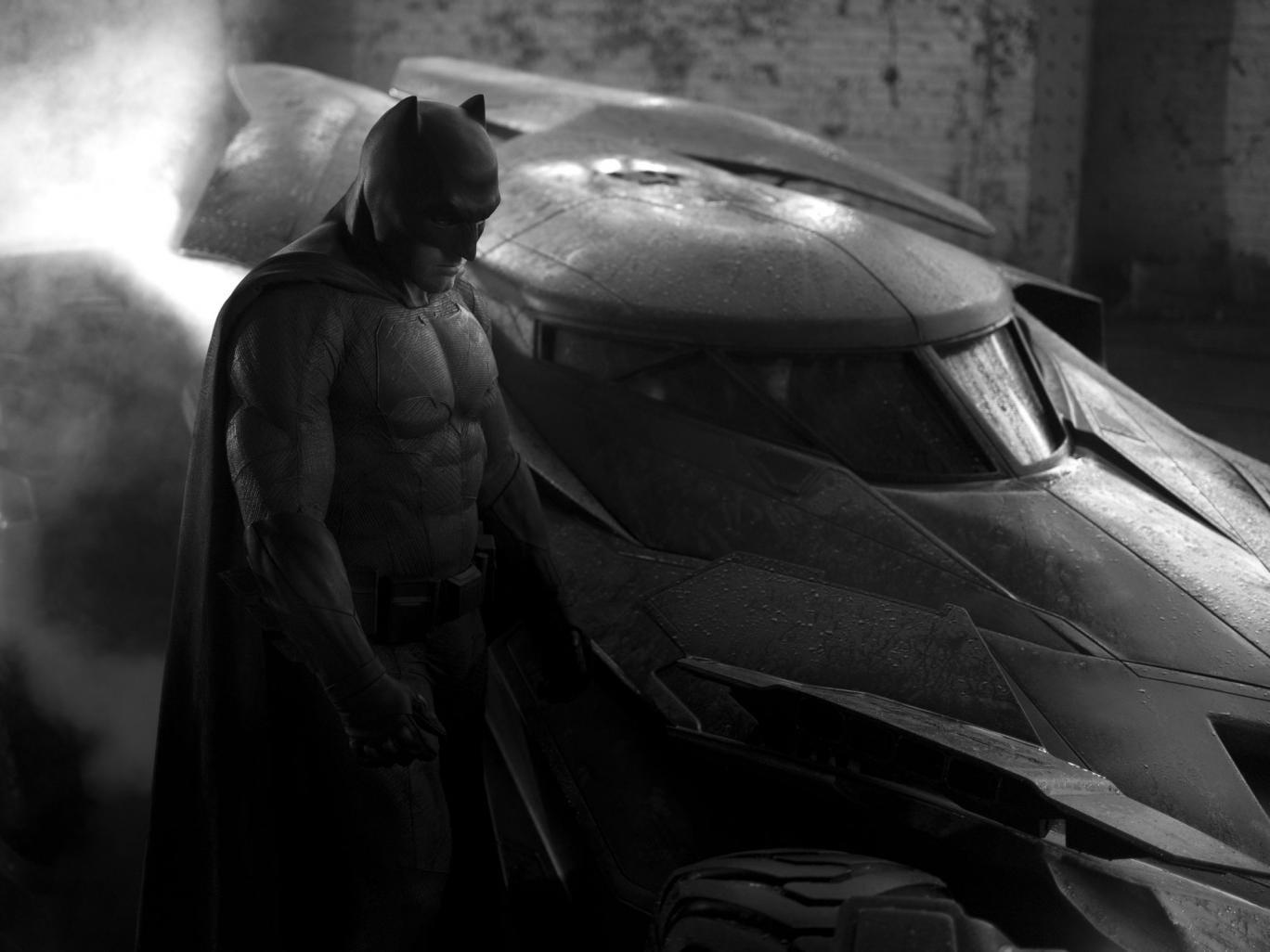 Ben Affleck as Batman with the batmobile in a Batman vs Superman teaser photo
