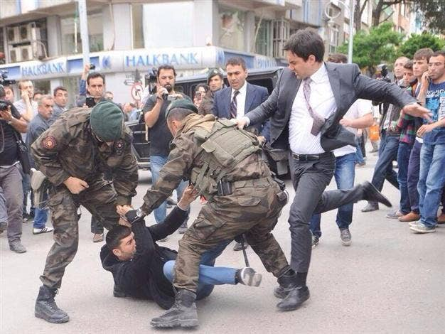 The moment the PM's aide Yusuf Yerkel was allegedly caught kicking a protester