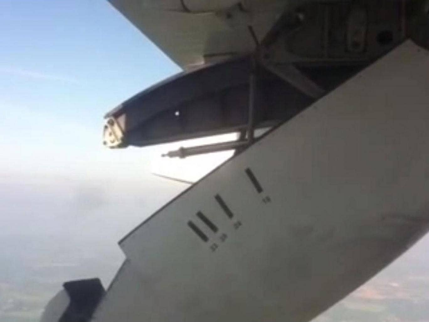 A still from footage of the City Jet flight showing the moment cover of the operating mechanism on the wing became partially detached