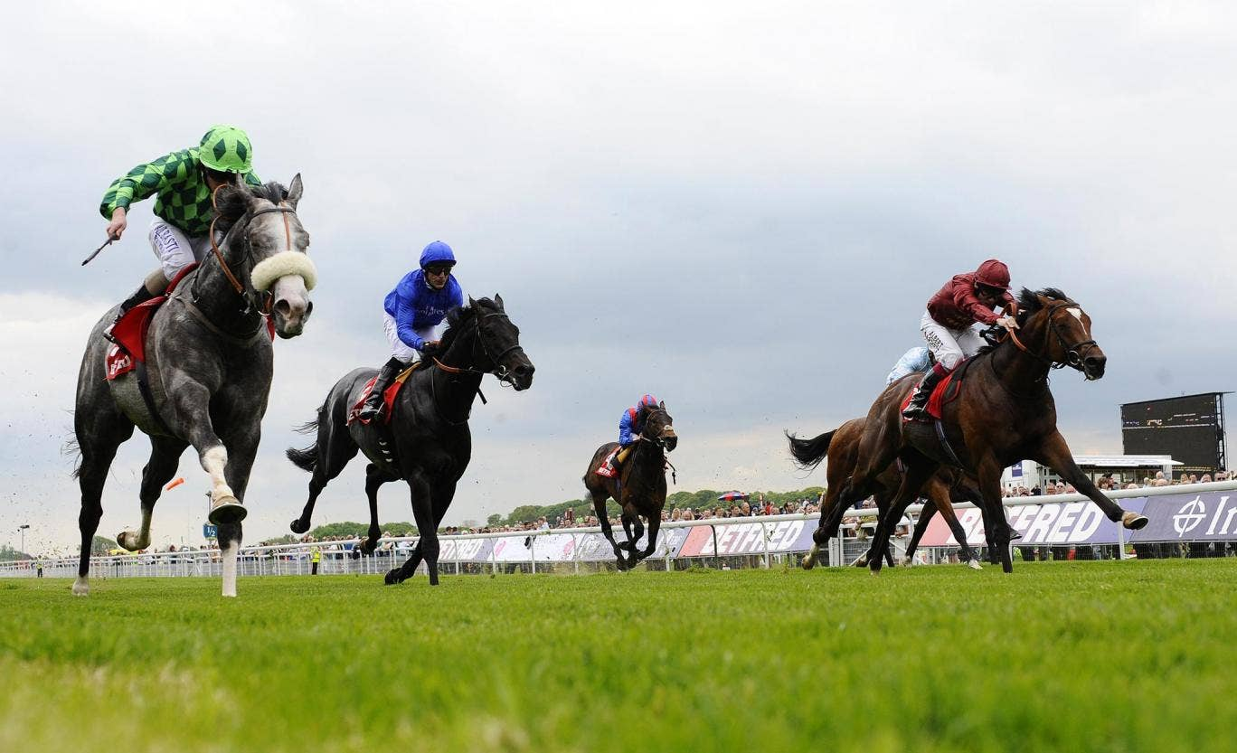 Ryan Moore riding The Grey Gatsby (left) wins the Dante Stakes at York with True Story and Kieren Fallon (second left) third