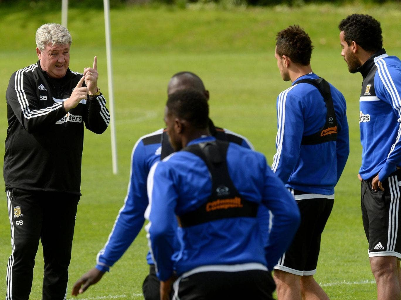 Steve Bruce discusses tactics with his players during a training session this week