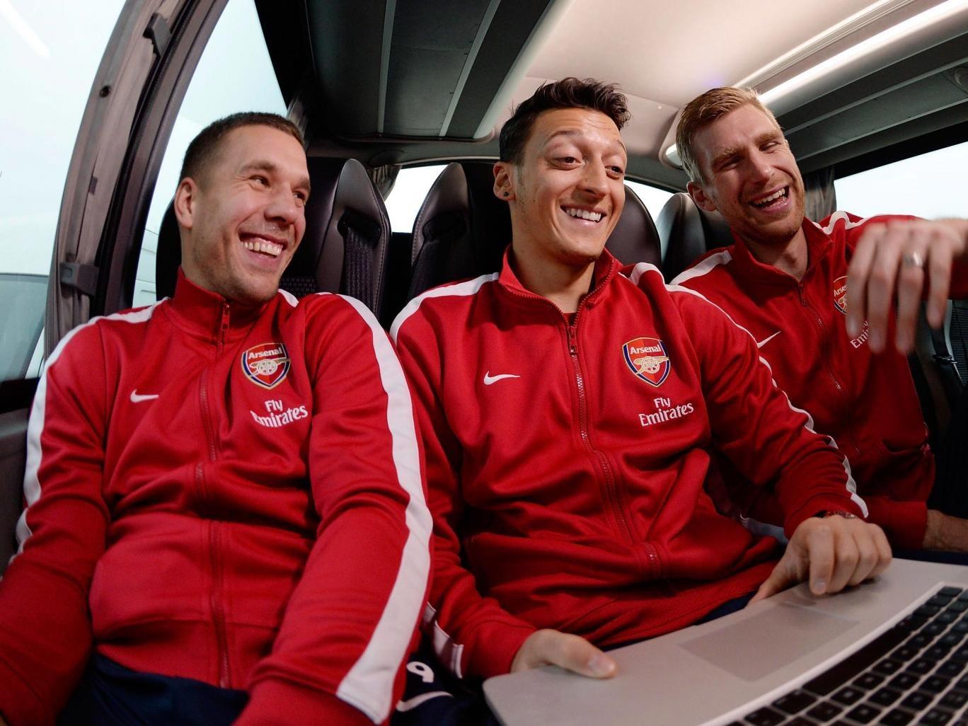 Left to right: Lukas Podolski, Mesut Özil and Per Mertesacker share a joke