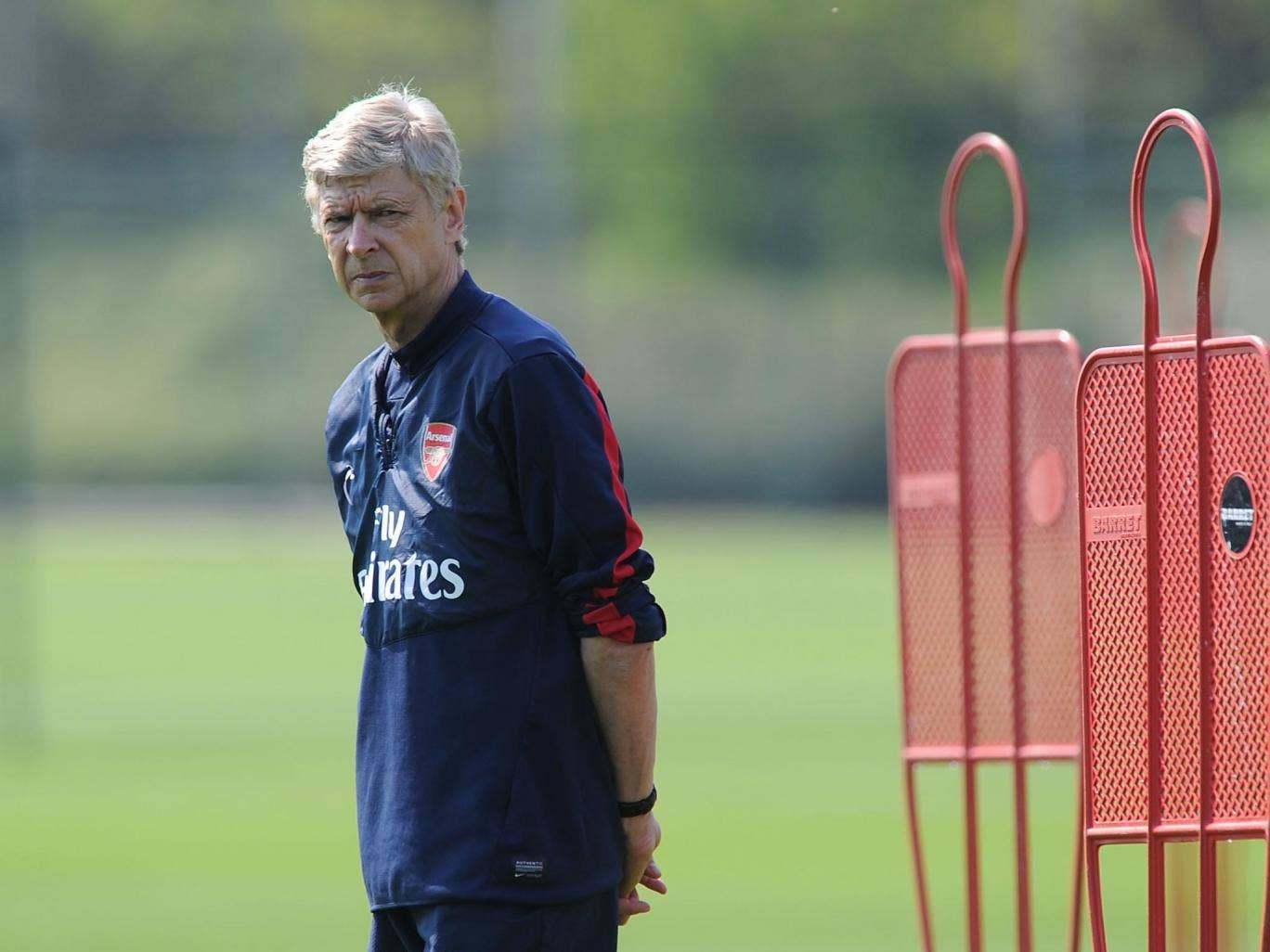 Arsène Wenger works with his players in training yesterday ahead of the FA Cup final