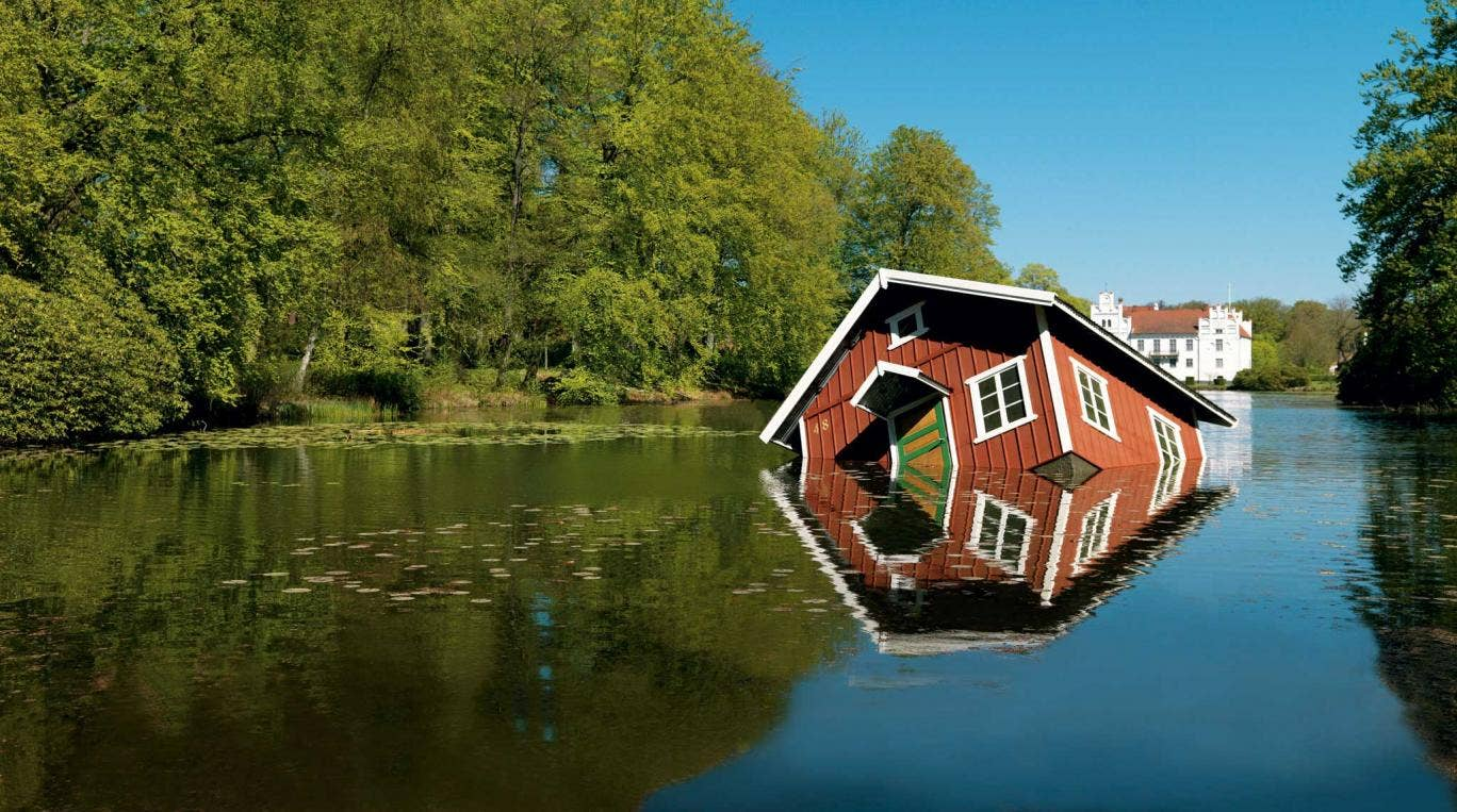 Arresting sight: Atlantis sees a small cabin tilted precariously to one side, and placed in the middle of a lake or river at European destinations such as Budapest and Reykjavik