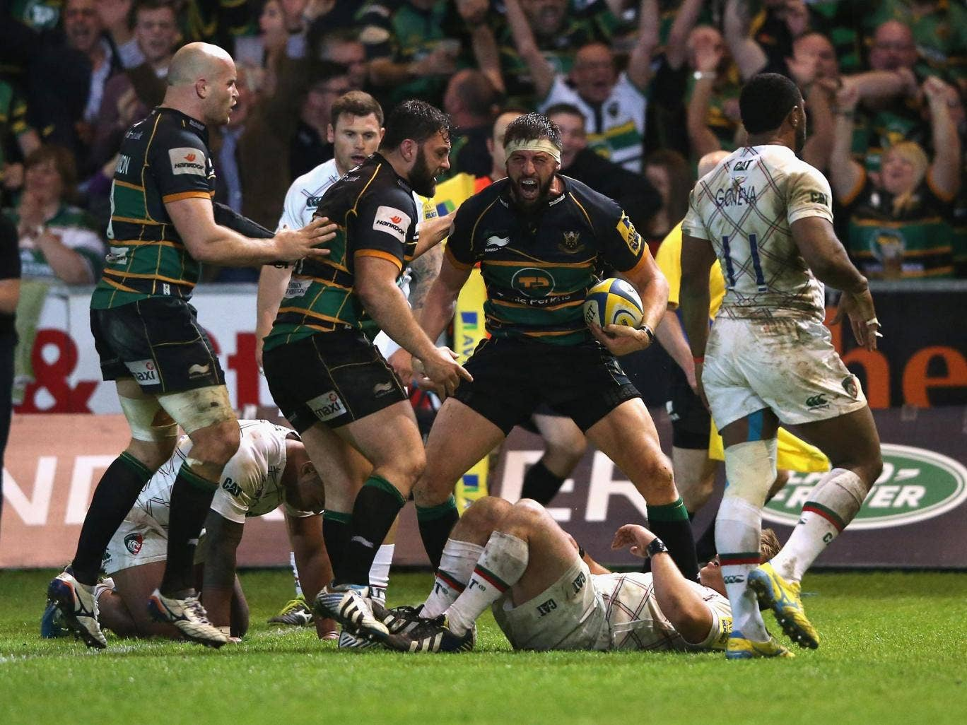 Tom Wood roars his delight after claiming the match-winning try last night