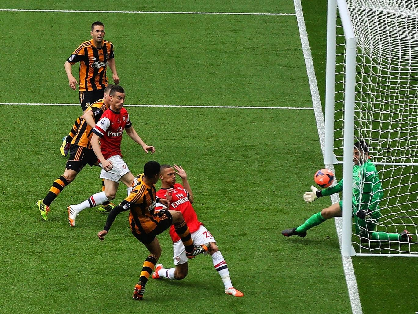 Curtis Davies scores Hull's second goal to make it 2-0 after eight minutes, much to the consternation of Arsène Wenger