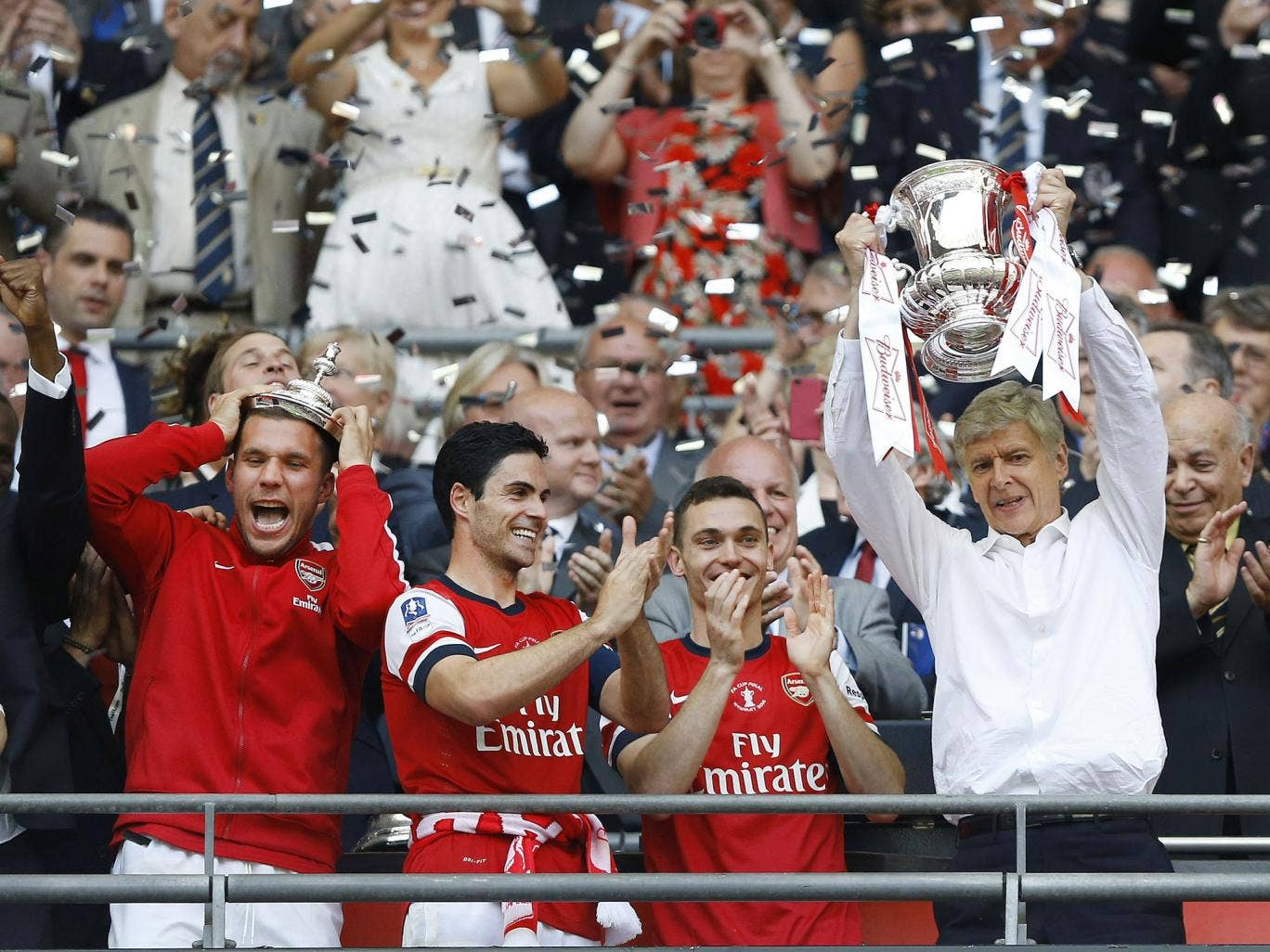 Back in the old routine: Arsène Wenger, the Arsenal manager, still remembers what to do with a trophy as he lifts the 2014 FA Cup after a thrilling 3-2 comeback victory over Hull City in the final