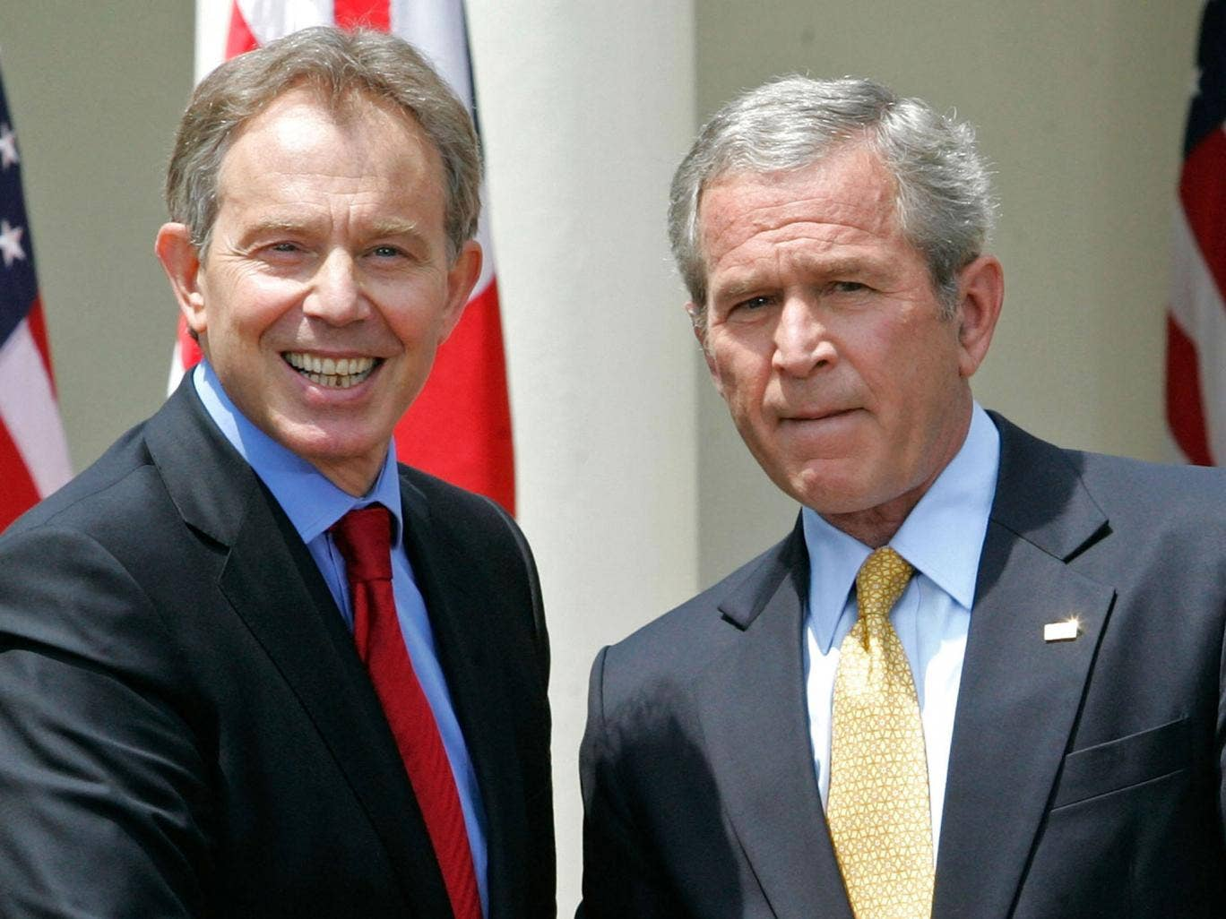 Tony Blair and US President George W Bush shake hands after a news conference in the Rose Garden of the White House in Washington, 2007
