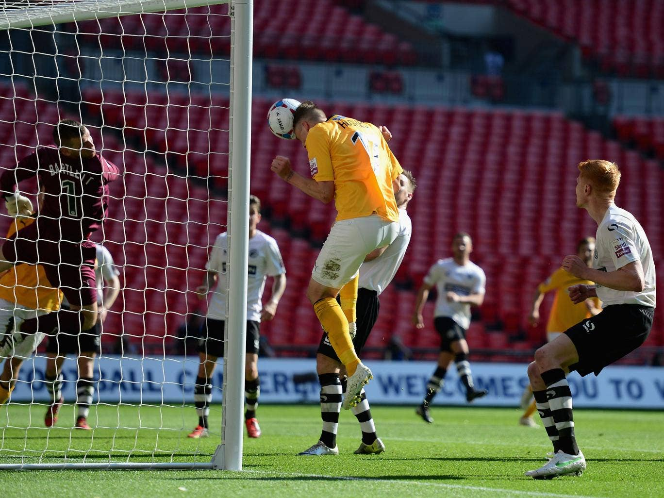 Liam Hughes opens the scoring for Cambridge at Wembley