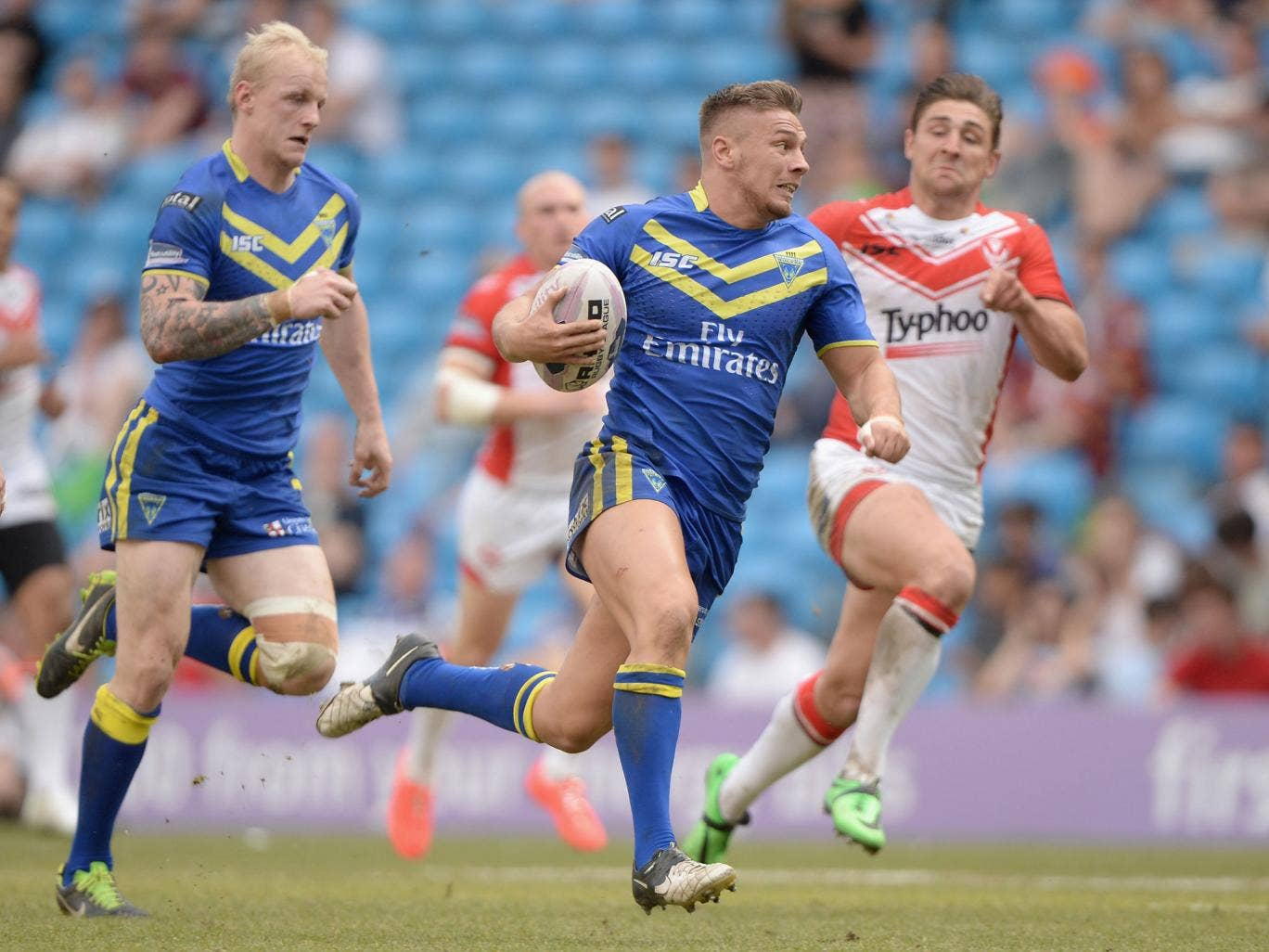 Matthew Russell sprints clear to score a try for Warrington