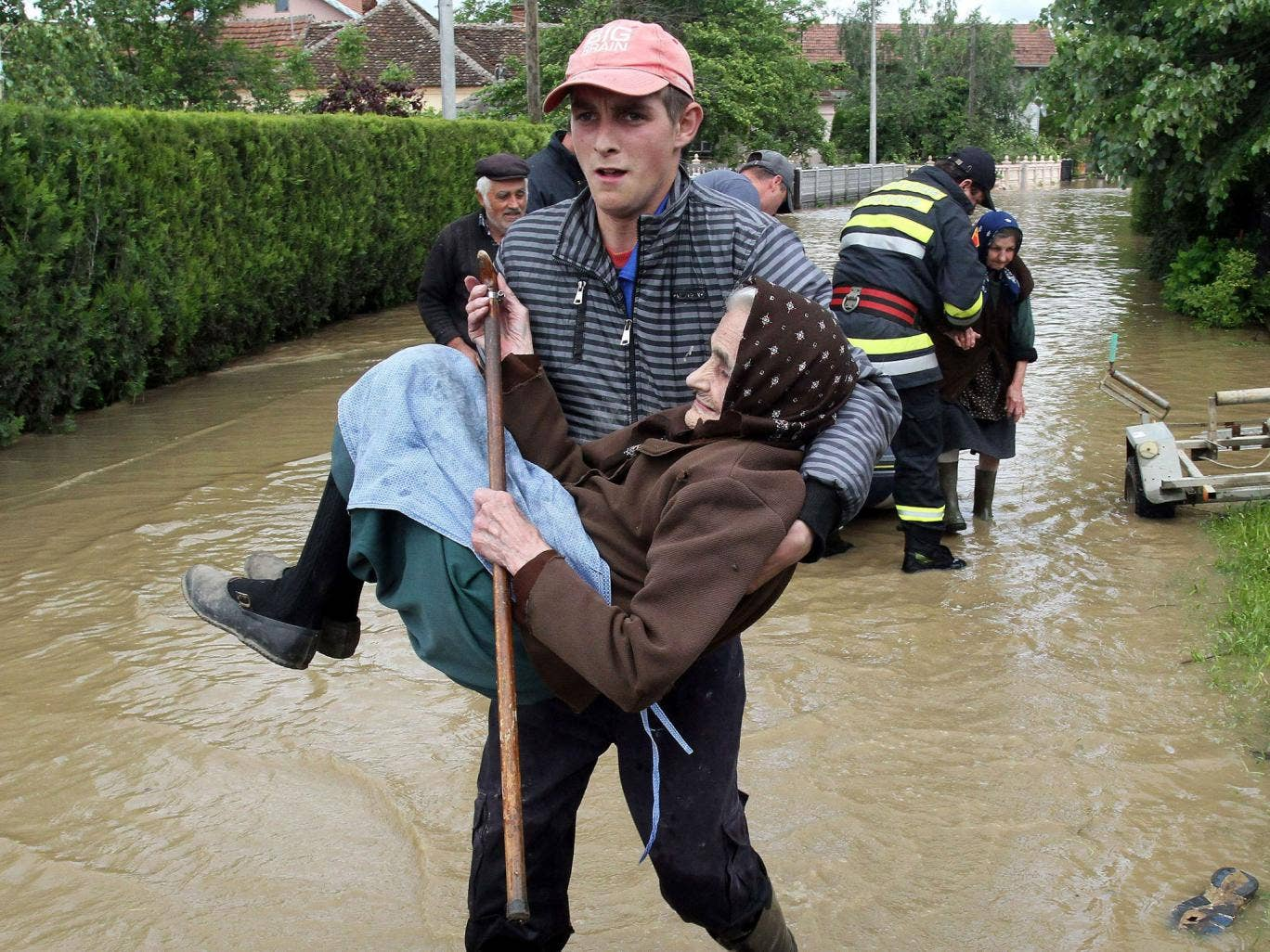 A Serbian rescuer carries an elderly woman out of her flooded house in the village of Obrez, near the central Serbian town of Varvarin, south of Belgrade