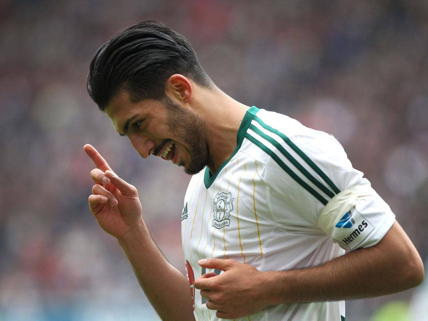 Leverkusen's midfielder Emre Can celebrates scoring