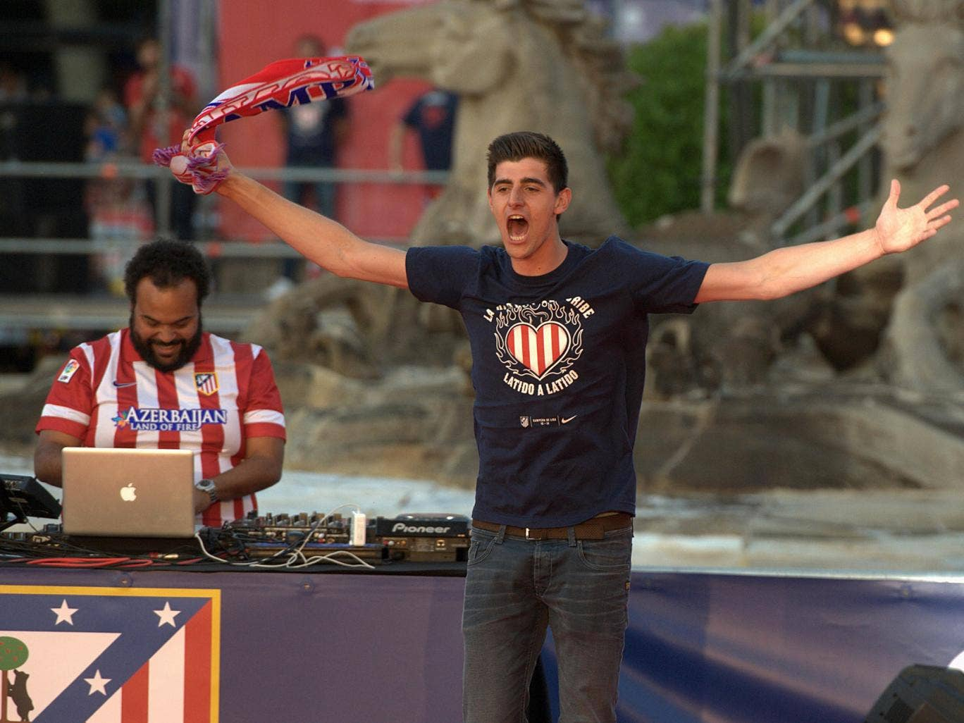 Thibault Courtois celebrates Atletico Madrid's La Liga success during the Madrid bus parade