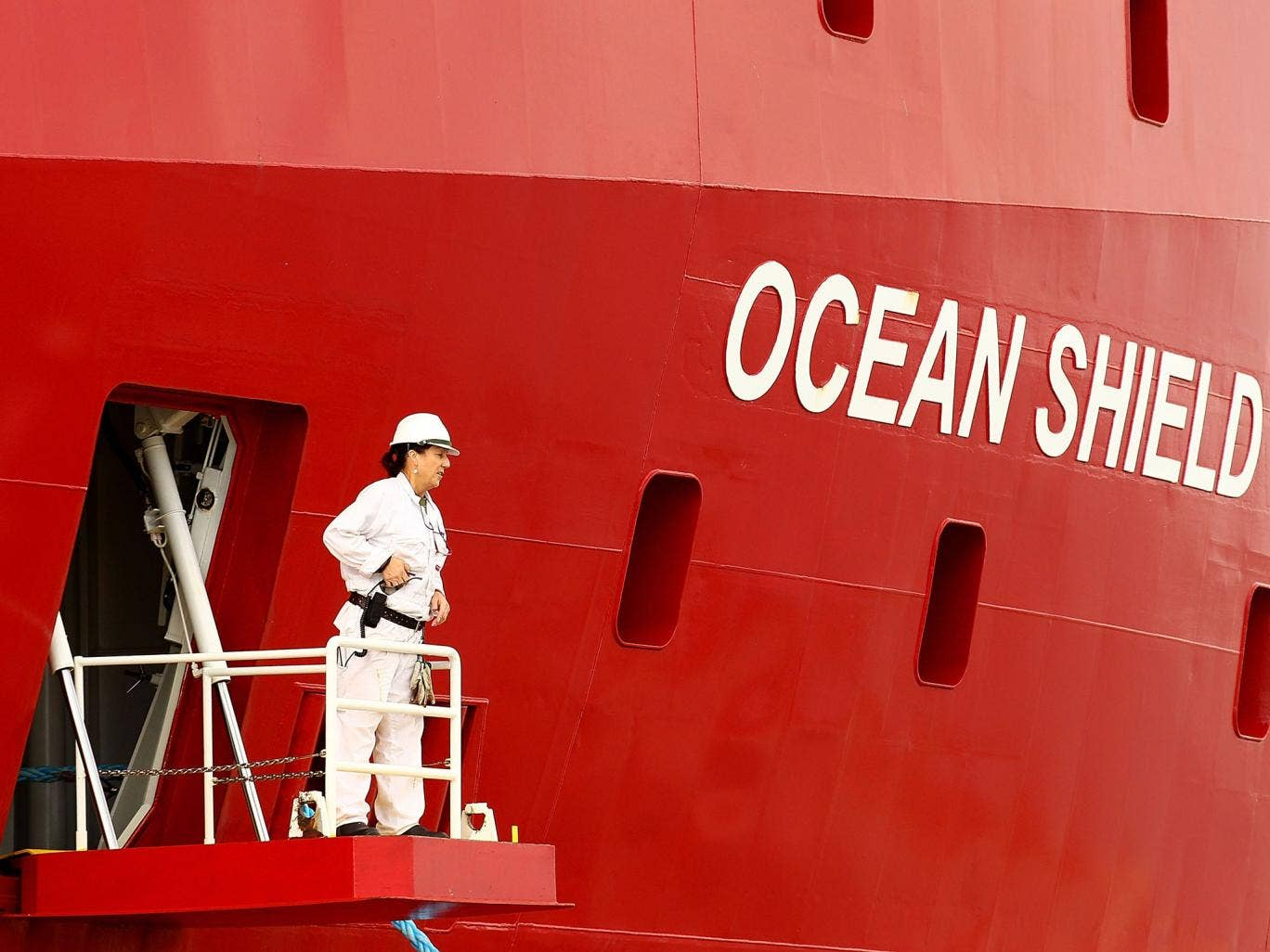 A crew member prepares for departure prior to ADV Ocean Shield slipping from the wharf at HMAS Stirling on May 10, 2014 in Rockingham, Australia. The Australian Defence Vessel Ocean Shield is departing for the MH370 search area today after resupplying at
