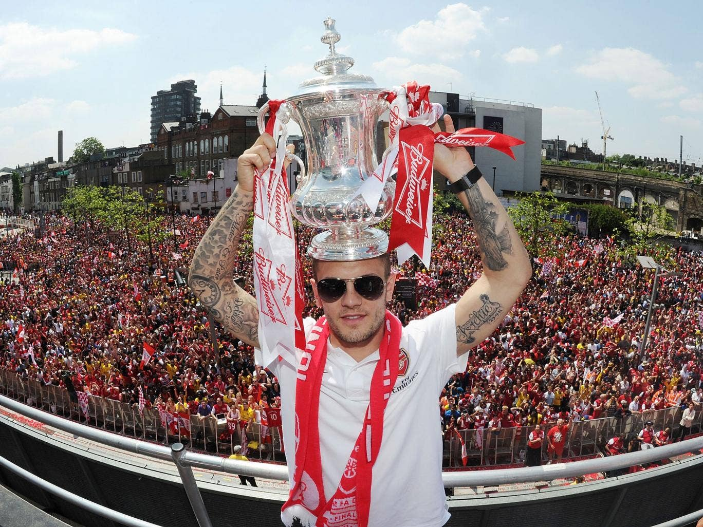 Wilshere poses with the trophy at the Arsenal Victory Parade