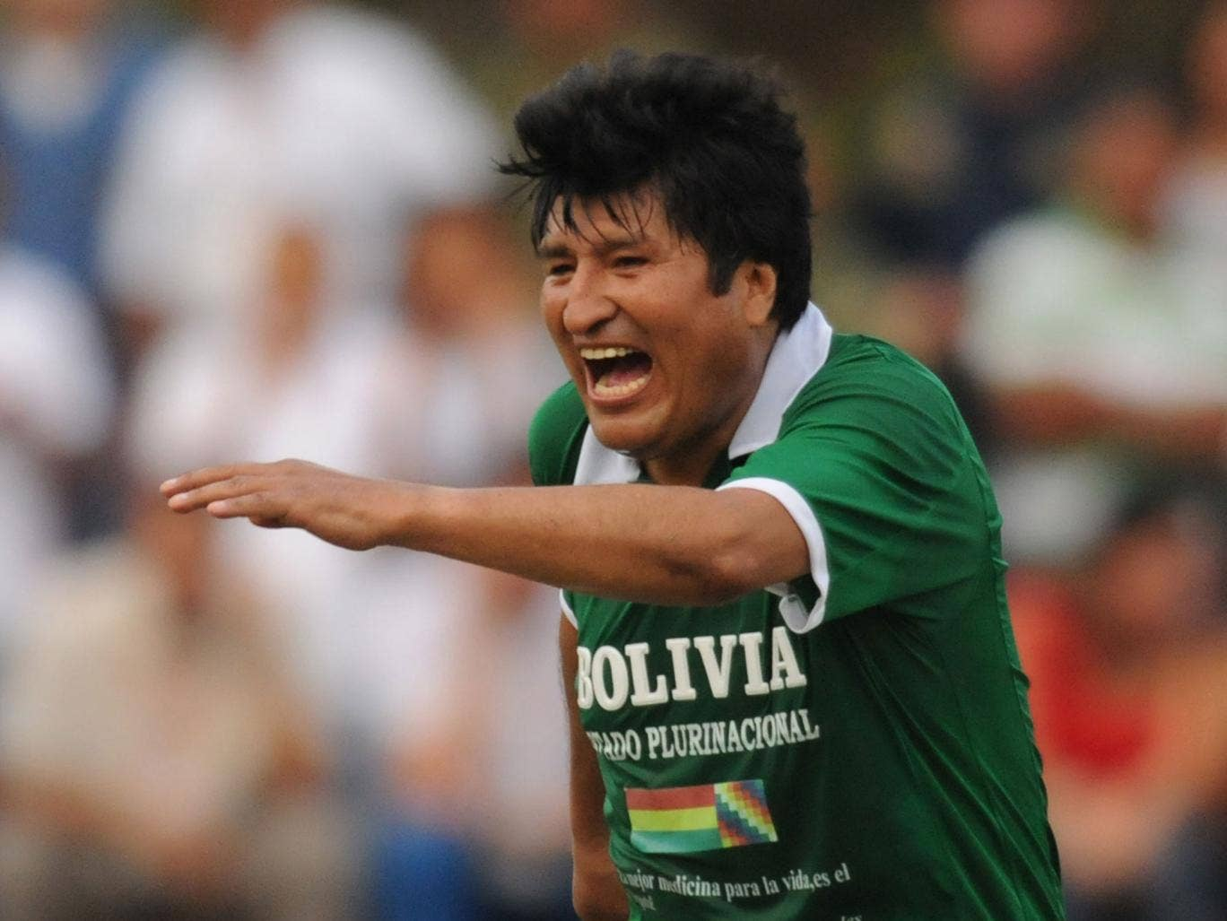 Bolivia's President Evo Morales celebrates his team's goal during a friendly football match against Colombia