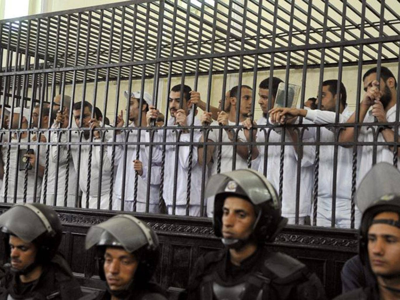 Defendants in court yesterday during their trial over violence in Alexandria last year following the ousting of Mohamed Morsi. Ahmed Diini was arrested shortly after Mr Morsi's Muslim Brotherhood was deposed