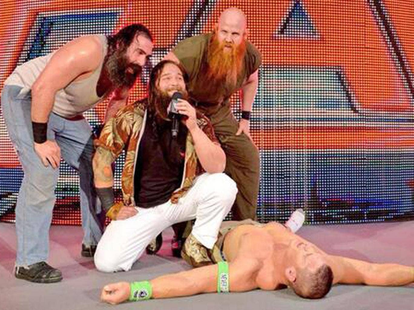 The Wyatt family stand over a beaten John Cena as Raw hits London