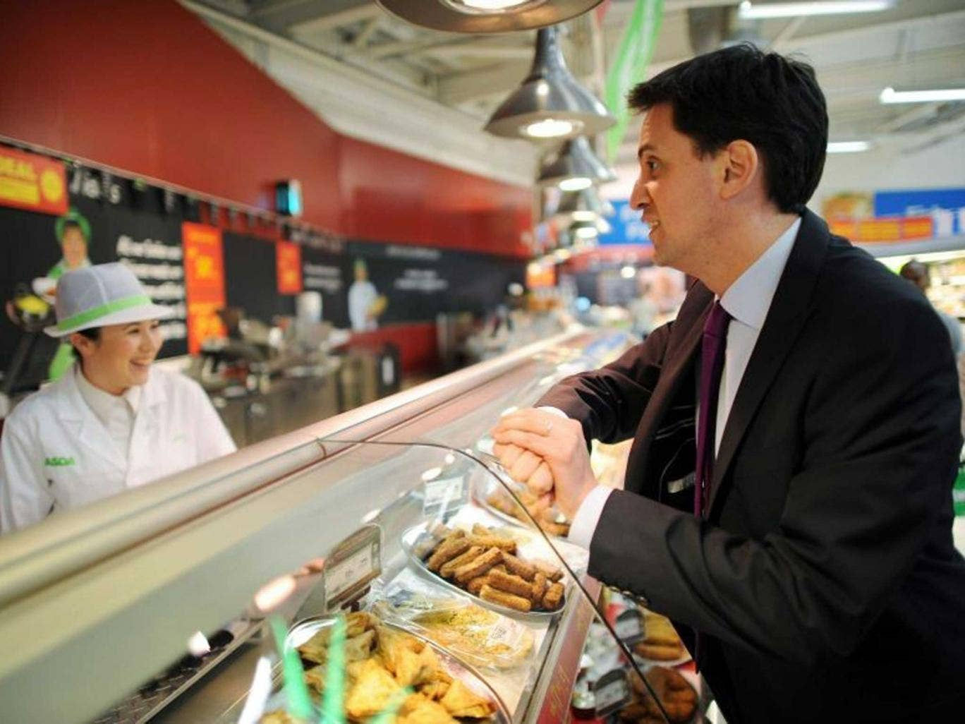 Miliband talks to a member of staff at an Asda supermarket in Harlow: the Labour leader recently admitted he didn't know the price of his own weekly shop