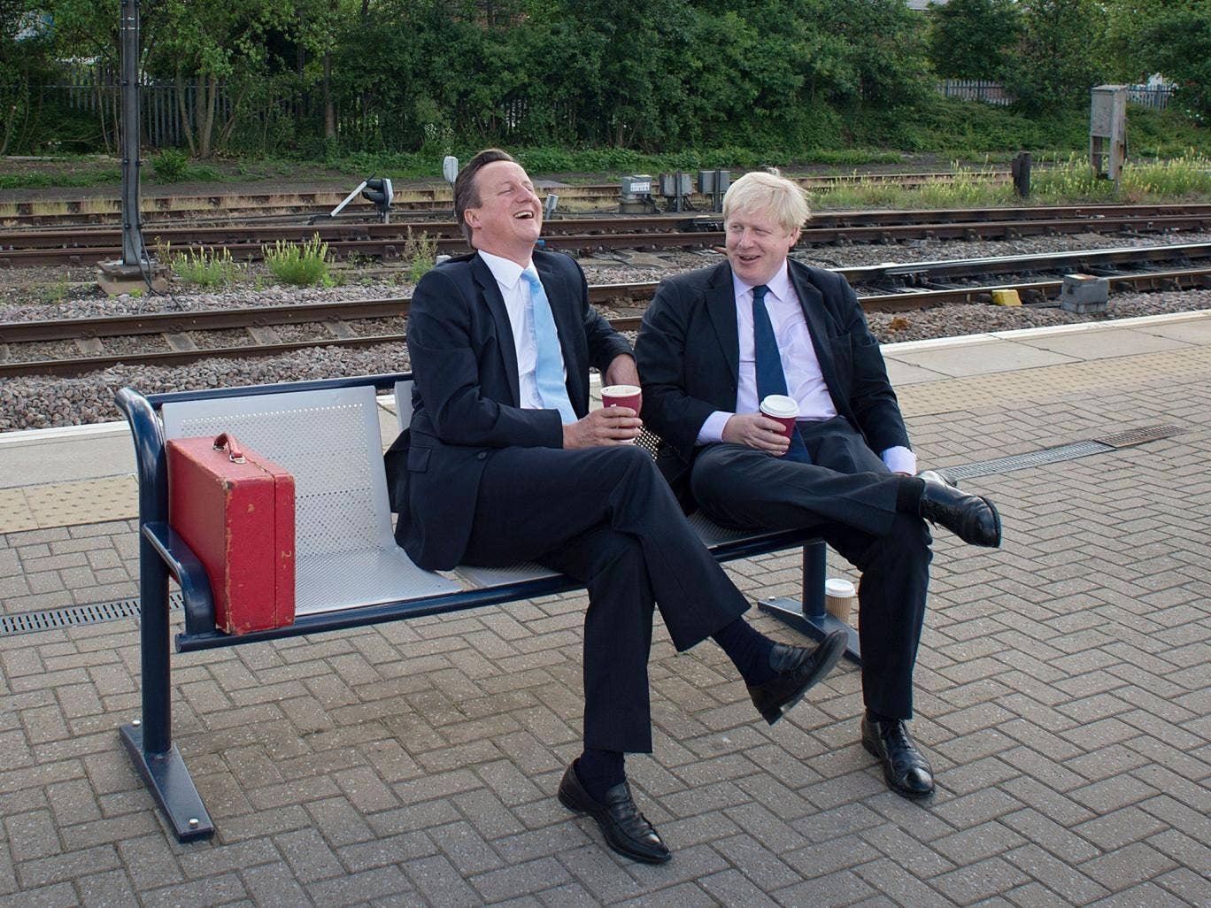 British Prime Minister Prime Minister David Cameron (L) and Mayor of London Boris Johnson wait for a train at Newark station in central England, following a visit to the town were they campaigned ahead of the Newark by-election