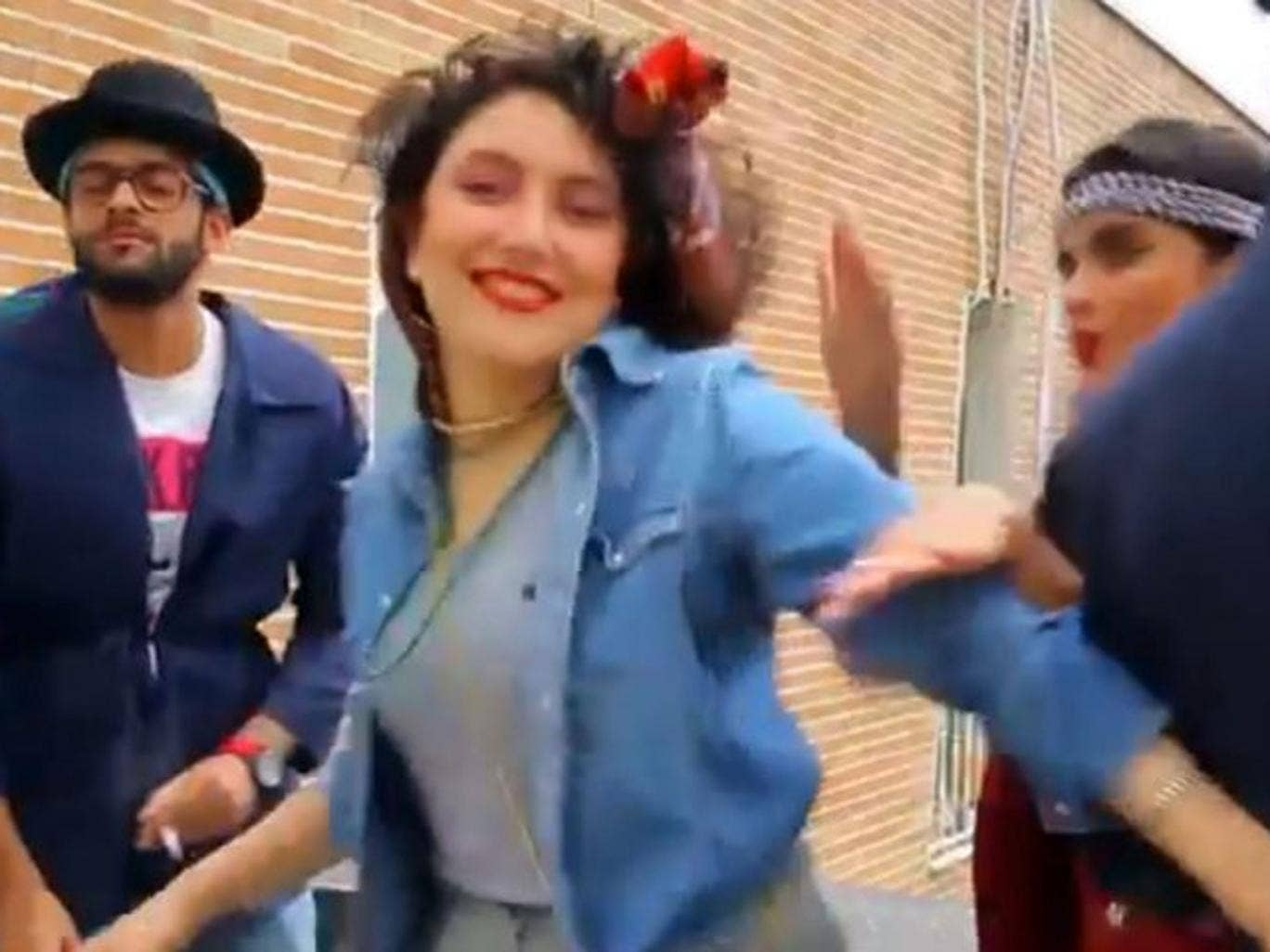 """In this frame grab taken from video posted to YouTube, people dance to Pharrell Williams' hit song """"Happy"""" on a rooftop in Tehran, Iran. Police in Iran have arrested six young people and shown them on state television for posting the video. While the song"""