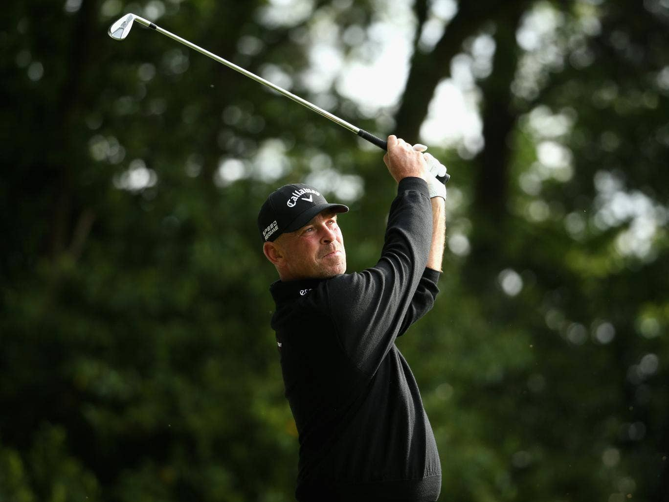 Thomas Bjorn of Denmark tees off on the 2nd hole during day one of the BMW PGA Championship at Wentworth on May 22 as he sets the early pace going eight-under through 14