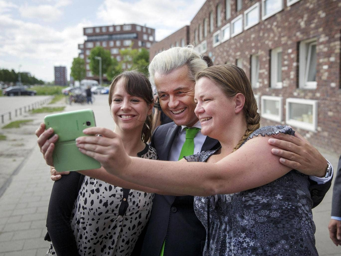 Geert Wilders, poses with supporters in The Hague