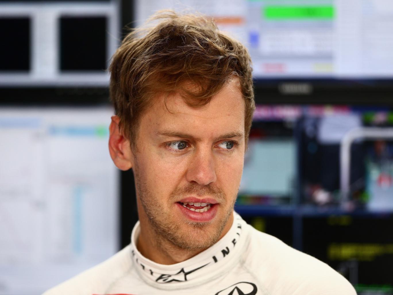 Sebastian Vettel looks on optimistically during practice for the Monaco Grand Prix