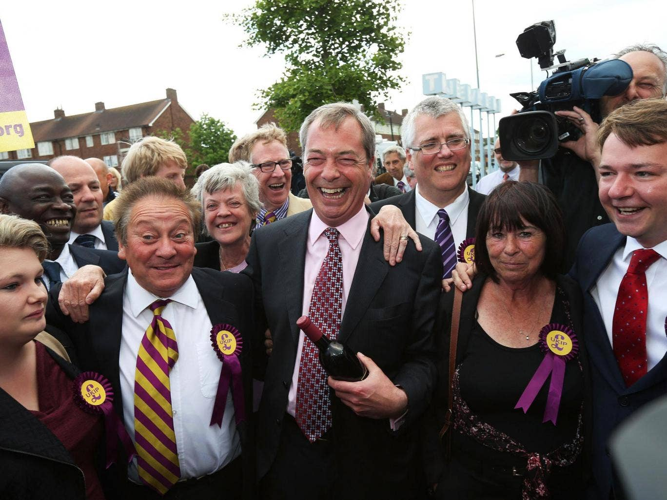Nigel Farage celebrates with local councillors in South Ockenden