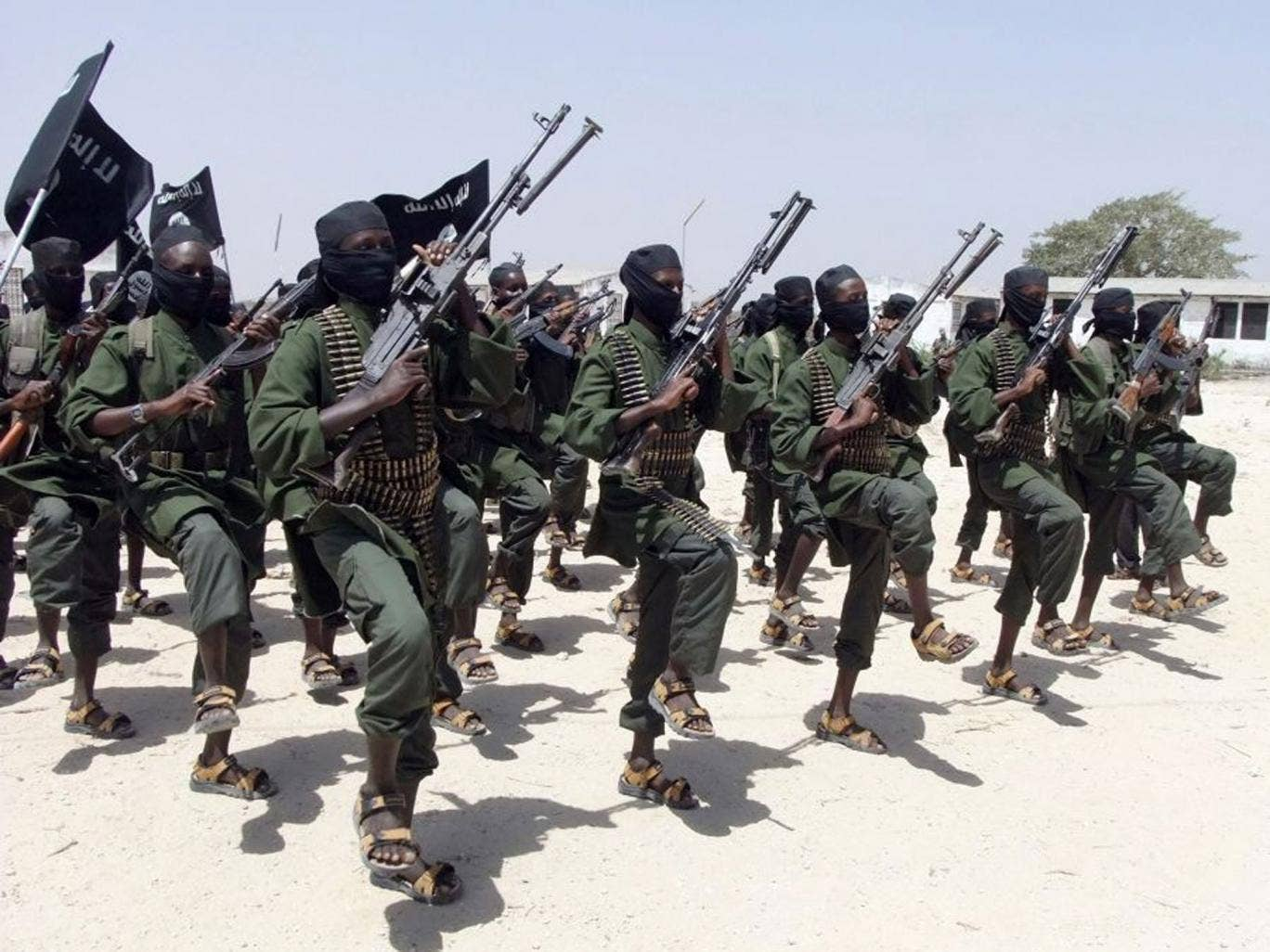 Pictured in 2011, hundreds of newly trained al-Shabab fighters perform military exercises in the Lafofe area some 18km south of Mogadishu, in Somalia