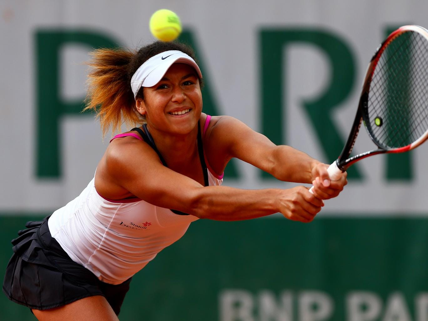 Heather Watson of Great Britain returns a shot in her women's singles qualifying match against Anett Kontaveit of Estonia during previews ahead of the French Open
