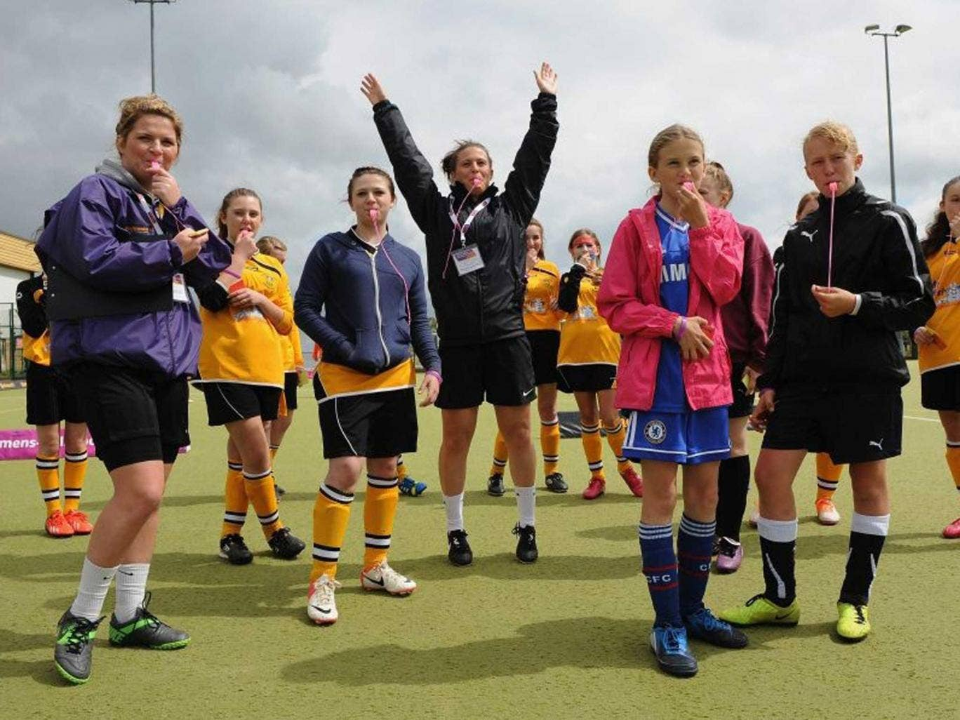 Girls getting fit and enjoying football in a refereeing workshop