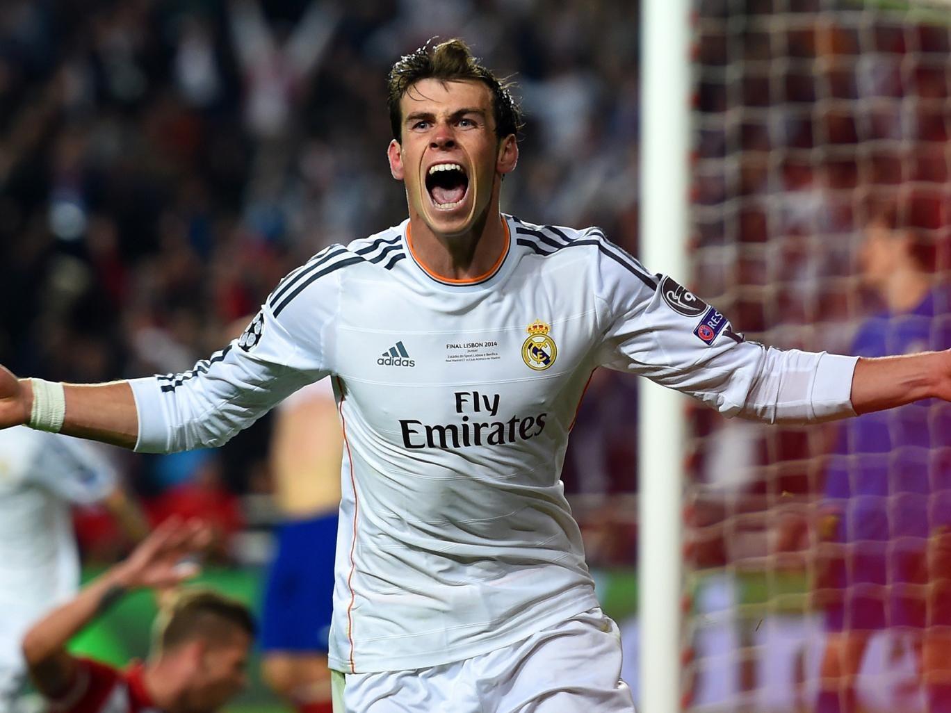 Gareth Bale celebrates scoring the winning goal in the Champions League final