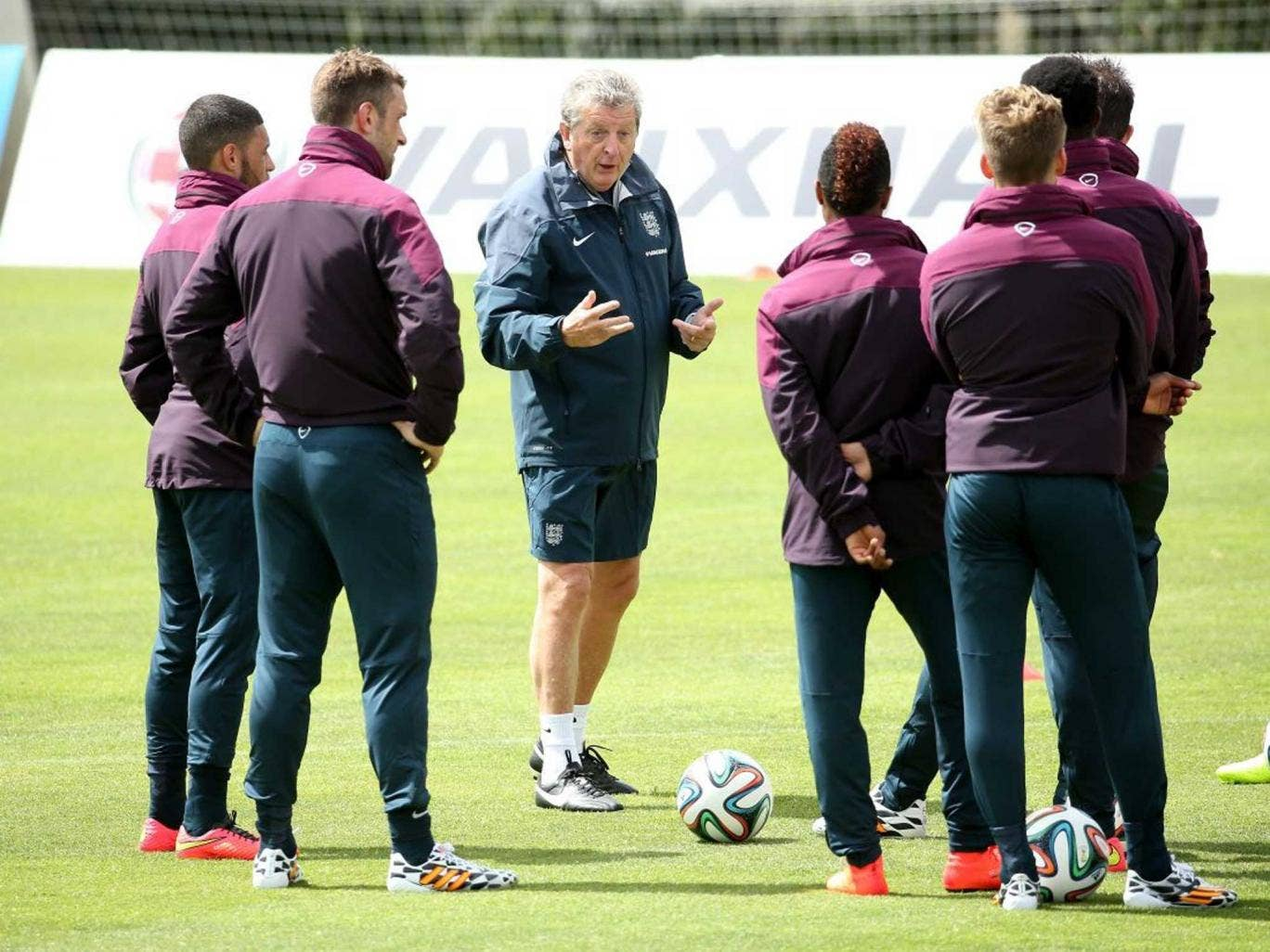 Vying for attention: England's World Cup hopefuls surround manager Roy Hodgson in Portugal last week