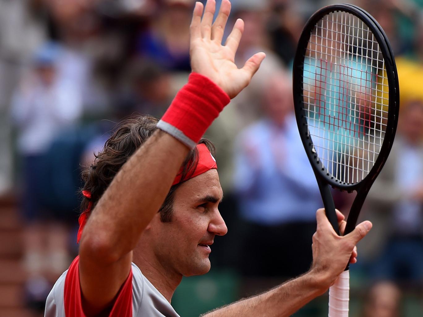 Roger Federer of Switzerland celebrates victory over Lukas Lacko