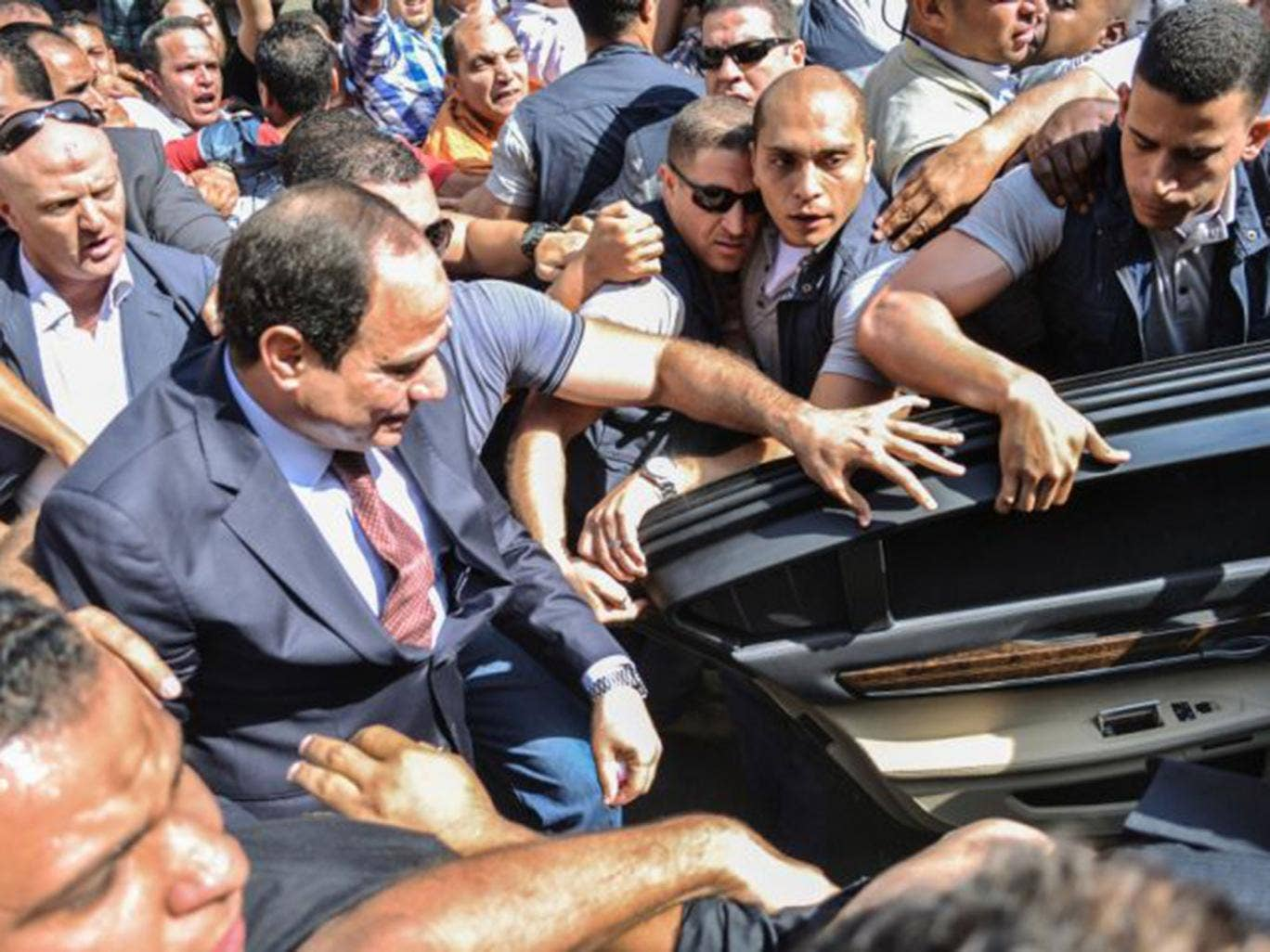Sisi (centre) led the coup last year against Morsi